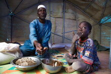 Photo: WFP/ Marwa Awad, A family eating their meal in Burkina Faso